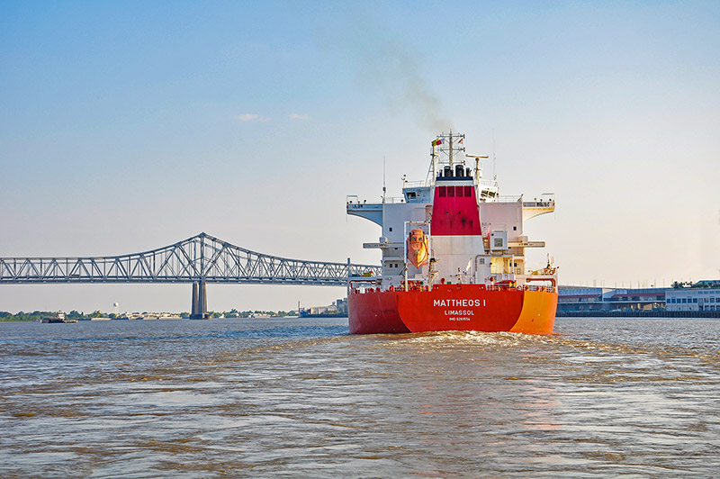 Greater New Orleans Bridge and Mattheos I tank-ship on Mississippi River, N.O., Louisiana