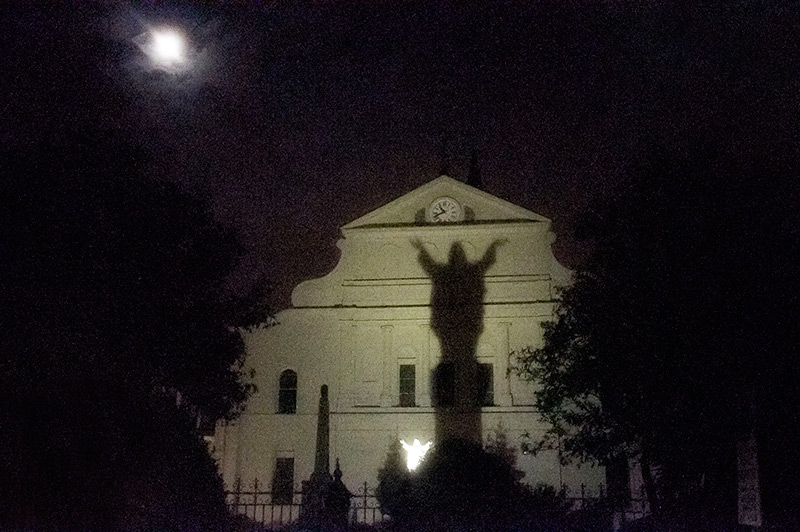Shadow of Christ statue on the back of St Louis Cathedral, Royal Street, New Orleans