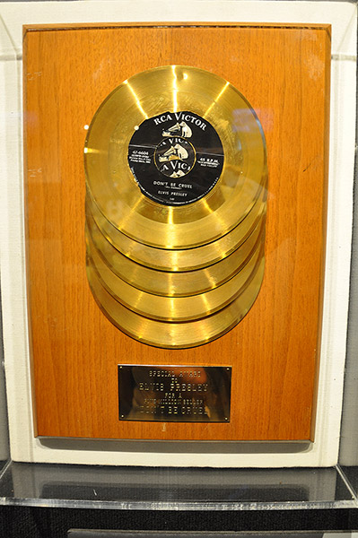 """Don't Be Cruel"" five golden records, Trophy Room, Elvis Presley's Graceland mansion in Memphis, Tn"