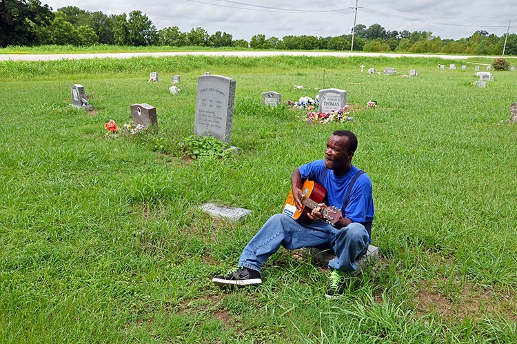 Pat Thomas plays at James 'Son' Thomas's sitegrave at Bogue Memorial Cemetery, Leland, Mississippi