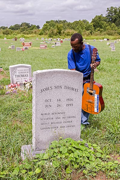 Pat Thomas at the grave of his father, James 'Son' Thomas, at the St Matthew Church, 364 Old Tribbett Road, Leland, Mississippi
