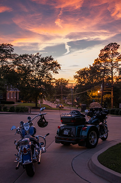 Sunset at Elvis Presley's birthplace, and bikers, Tupelo, Ms